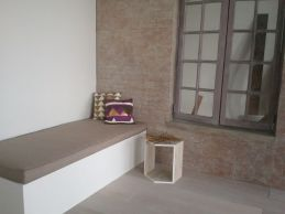 Painted set for Berkus's designs for Target 2013, including faux patina on brick wall.