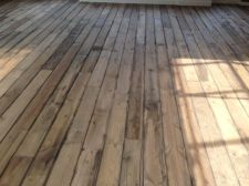500 Planks of pale pine were painted each individually to resemble old weathered wood.