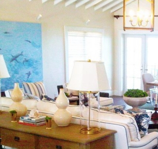 """""""Sharks"""" mural installed on left wall at Highbourne Cay."""